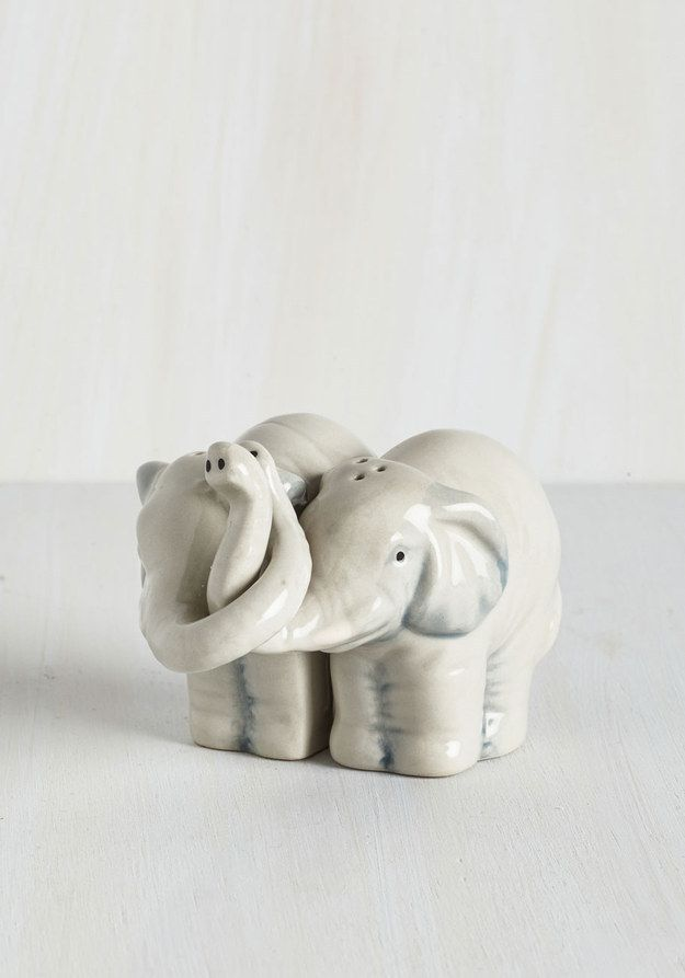 These cuddling salt and pepper shakers. | 32 Products Every Elephant Lover Needs In Their Home