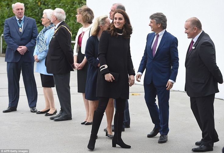 The beaming Duchess is greeted by dignatories including CEO of Jaguar Land Rover. Nov 22 2017, black Goat coat, third pregnancy
