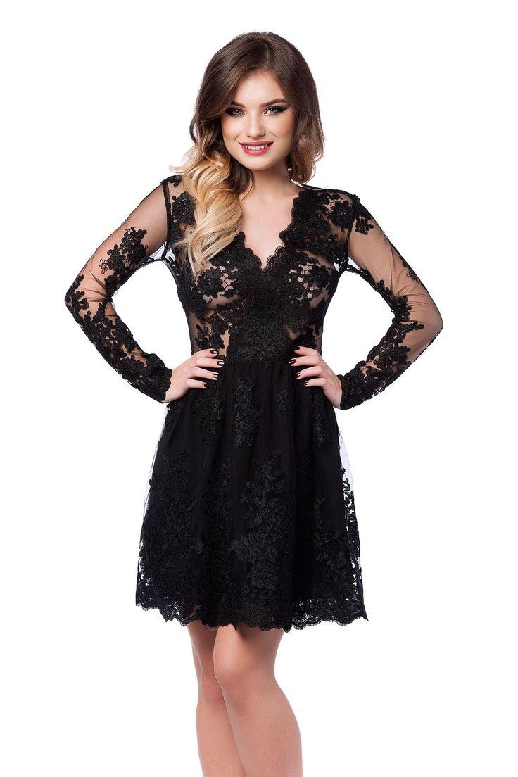 Rochie Selin Neagra - O rochie de seara scurta cu accente glamour, Selin reprezinta piesa de rezistenta a unei aparitii spectaculoase la un banchet, o gala, un bal sau orice eveniment special. Rochia scurta de seara este confectionata integral din dantela pretioasa brodata manual, care reuseste, simultan, sa acopere suficient de mult incat sa iti confere o alura misterioasa, dezvaluind, totodata, suficiente detalii incat sa iti asigure un plus de senzualitate. Manecile lungi ale rochiei de…