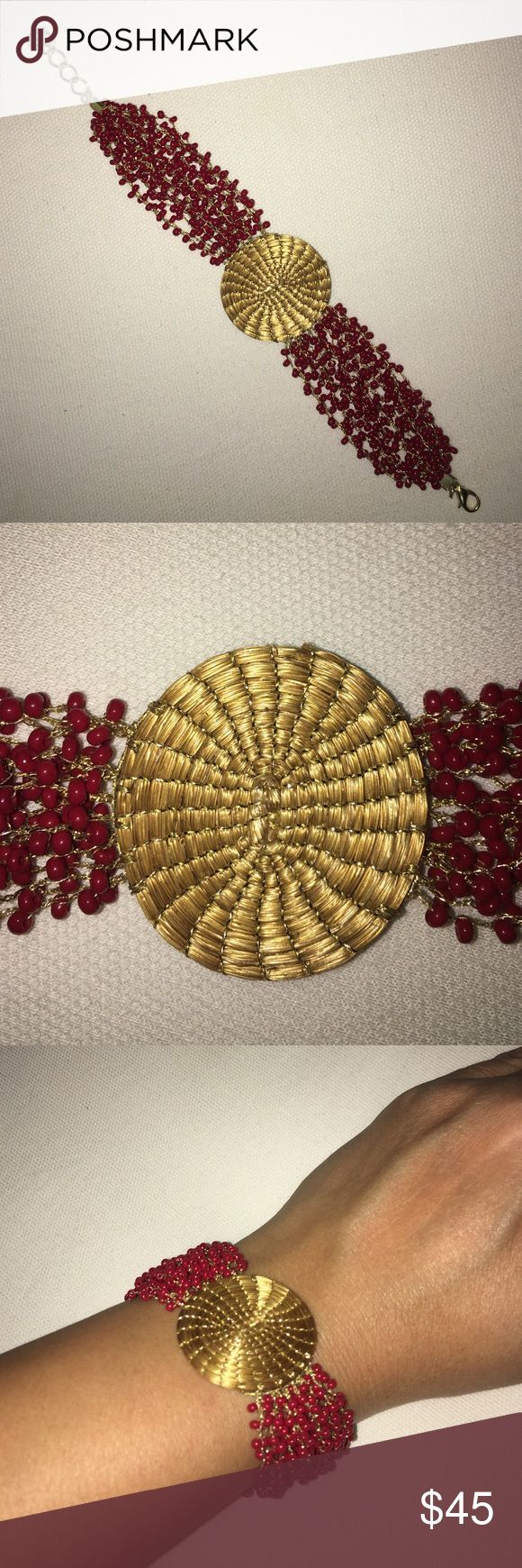GOLDEN GRASS and red garnet gemstones bracelet This listing does not include handbag. Golden grass and gemstone bracelet. Beautiful sporty chic bracelet. Gold plated. Made in Brazil, and purchased there. Item will be videotaped prior to shipping to ensure proof of condition. Jewelry Bracelets