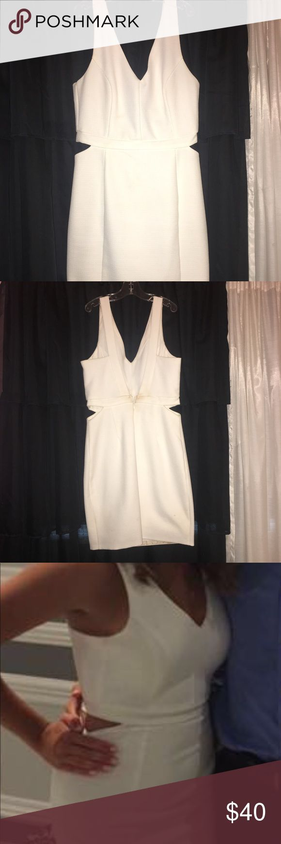 White cut out, low back dress White dress with a low back and side cut out. there is a makeup mark on the back, but I will gladly dry clean before selling. Nordstrom Dresses Mini