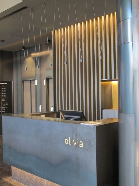 The MATCH lighting fixture has been used on the ground floor to highlight the reception desks and the bar.Its light structure does not clash with the background and allows to enhance the lighting. Its design is both pure and neutral. http://www.vibia.com/en/lamps/show/id/00034/hanging_lamps_match_design_by_jordi_vilardell_meritxell_vidal.html: