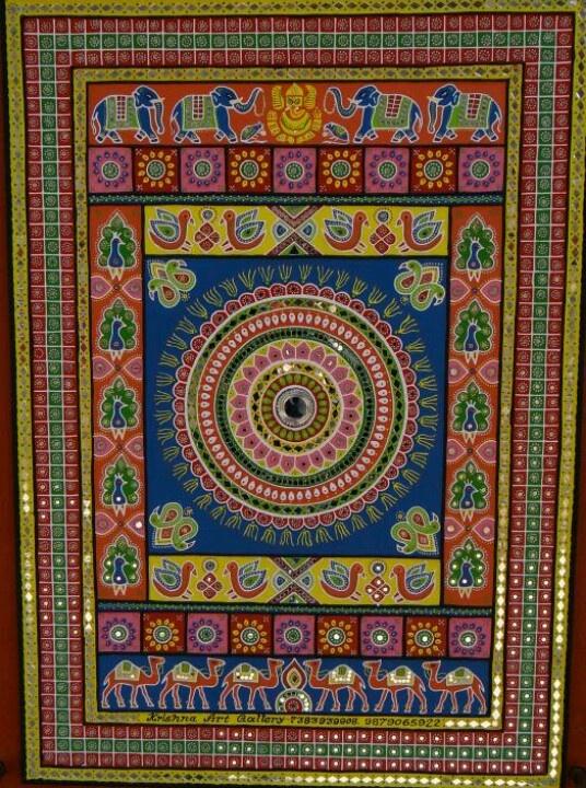 A Traditional Gujarati Artwork With Mirror Work On Mud