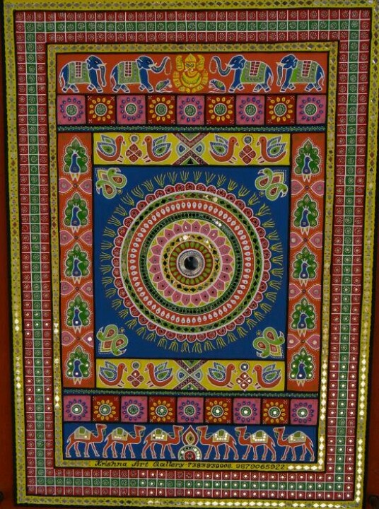 A traditional Gujarati artwork with mirror work on mud