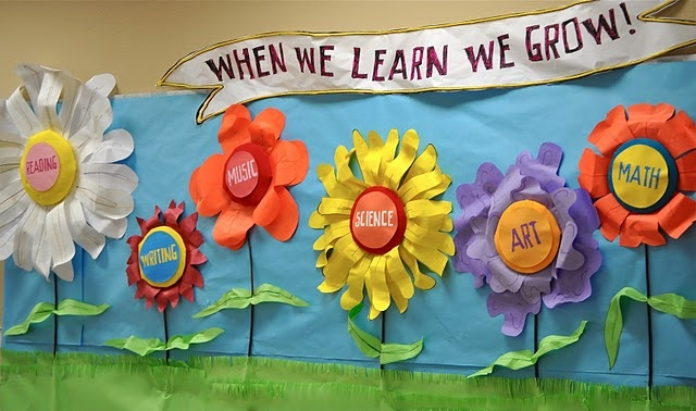 Spring School Bulletin Board - so cute and colorful! I would use pinks and purples for the flowers with the green stem & blue sky. Great color combo.