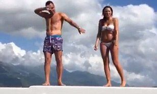 JOHN TERRY and wife Toni celebrate England's win over Wales with unusual dance on a boat in Croatia...