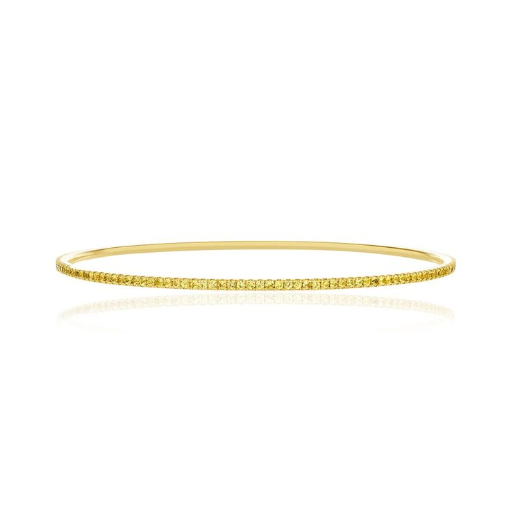 18kt yellow gold and sapphire bangle bracelet.