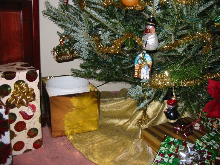 Hidden Christmas Tree Watering System- made this last year and the tree still looked great after vacation!