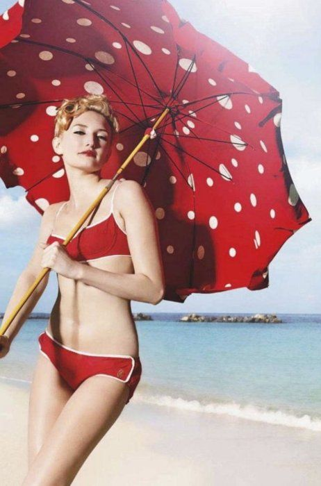 Polka dot umbrella and a red suit on a perfect beach!