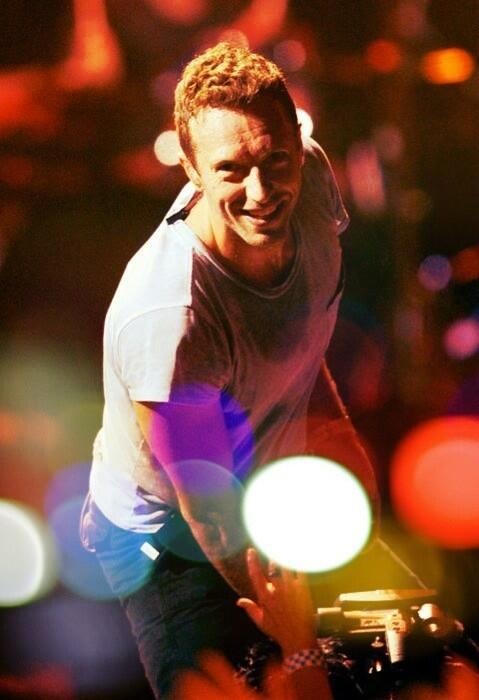 Coldplay - Chris Martin is a gifted musician.  I love the way that he includes his audience......encouraging them to sing along with him.  :)