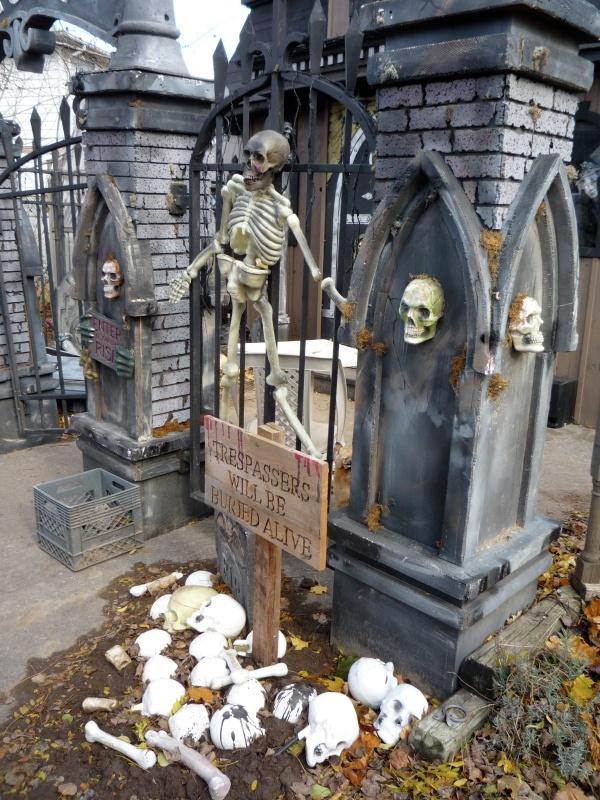 Halloween cemetery pillars, bones & sign