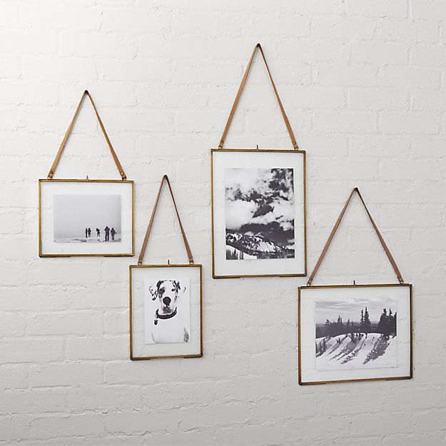 Shop brass floating picture frames.   Handmade brass frames with clear glass overlays float fav photos, memories, even dried botanicals.  Natural leather hanging strap delivers accessory appeal.