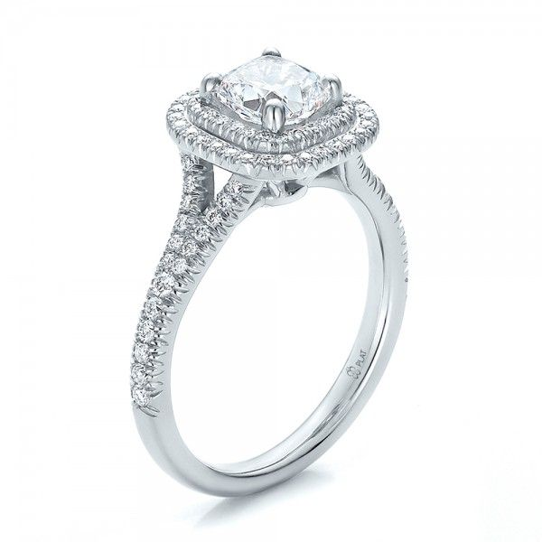 This beautiful engagement ring features a cushion diamond surrounded by a double halo of French cut set diamonds that continue down the sides of the split shank.
