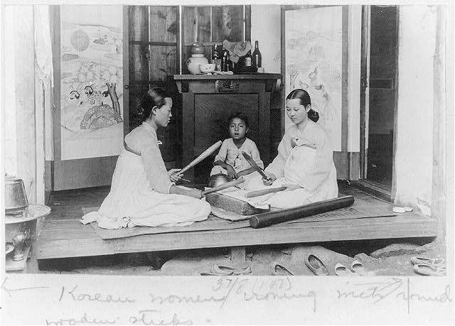 Korean women, ironing with round modern sticks. [Korea, 191-]