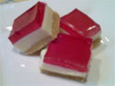 A delicious three layered slice consisting of a firm biscuit base, a luscious creamy lemon middle, topped with smooth jelly.