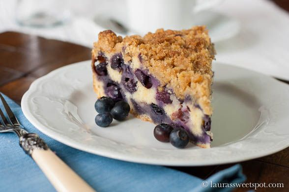 This Blueberry Buckle is coffee breakfast cake: nice,moist, light and fluffy and just packed with blueberry goodness.  The buckle is an old-fashioned, single-layer cake with a struesel-type topping,and this fruit dessert cake makes no exception.  It's a great go-to recipe for just about any occasion.  It can be made with fresh or frozen blueberries or with a different berry.  Enjoy!