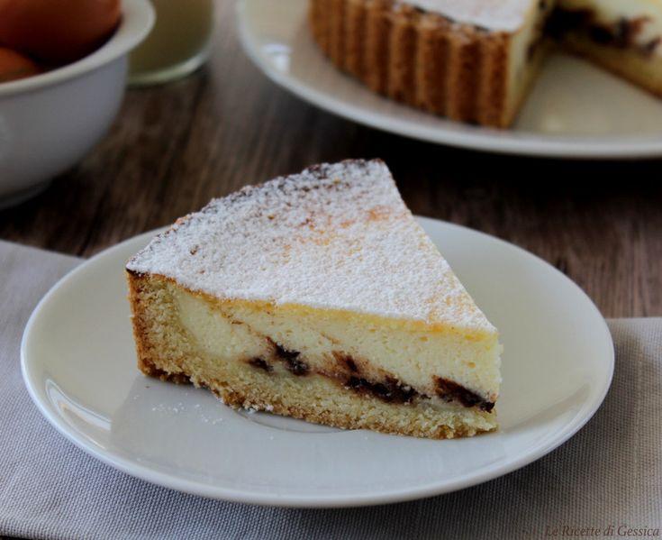 Ricetta della crostata di ricotta bimby e metodo tradizionale con cioccolato, profumata al limone. Morbida frolla farcita di golosa crema alla ricotta