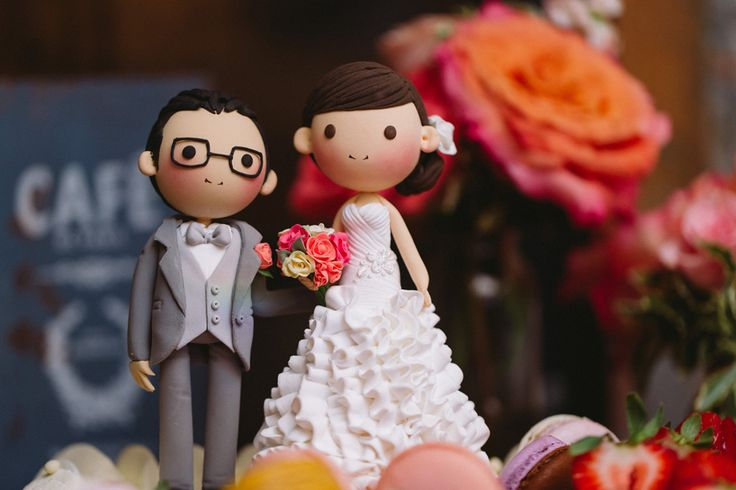 Their Cake Topper -Made to look just like them in their Wedding Suit and Wedding Dress- Too cute! http://www.fusion-events.ca/