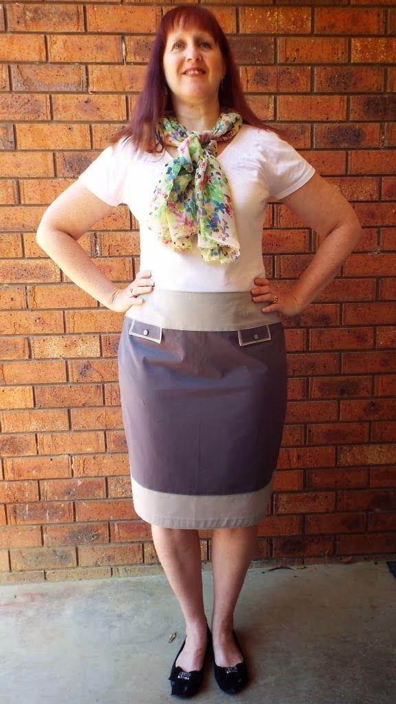 a two tone grey skirt with false pocket flaps