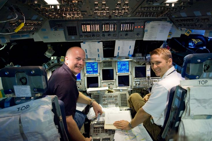 high res (1.6 M) low res (109 K)  JSC2009-E-207318 (11 Sept. 2009) --- NASA astronauts Alan Poindexter (left) and James P. Dutton Jr., STS-131 commander and pilot, respectively, participate in a training session in the shuttle mission simulator (SMS) in the Jake Garn Simulation and Training Facility at NASA's Johnson Space Center.