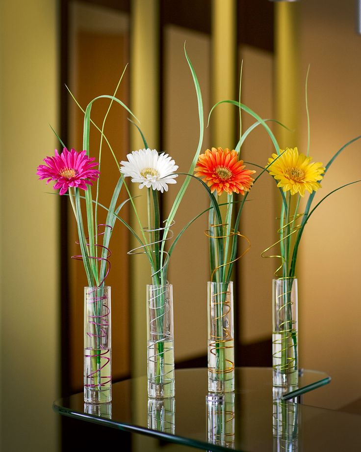 Silk Gerbera Daisy And Grass Along With A Tornadic Twist Of Floral Wire In Our Acrylic Water