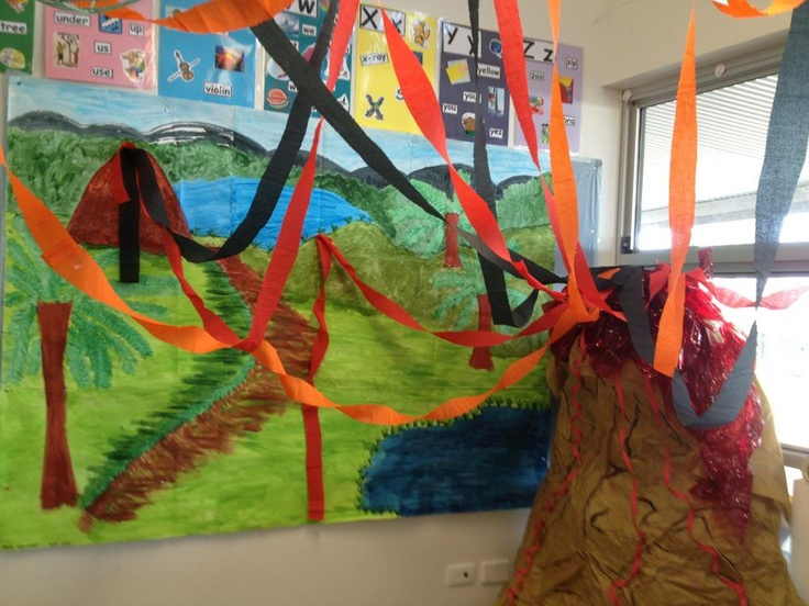 Volcano made with paper and glue. Painted and we used crepe paper to create the lava effect. It's about 6 feet high!