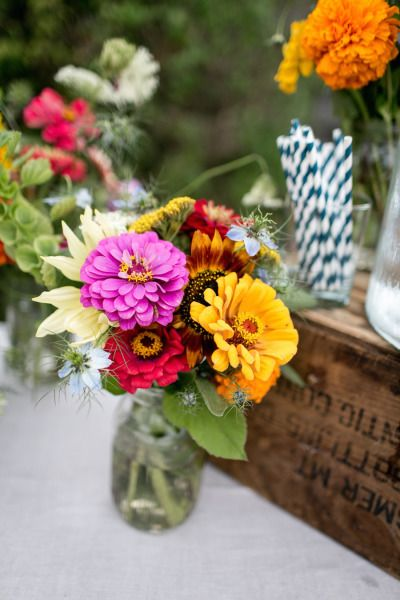 Bright flowers: http://www.stylemepretty.com/connecticut-weddings/old-lyme-connecticut/2015/04/03/eco-chic-outdoor-wedding-in-connecticut/ | Photography: Brookelyn - http://brookelynphotography.com/