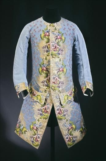 View of a waistcoat worn by Claude Lamoral II (1685–1766), Prince of Ligne and the Holy Empire, c.1750. Front: Brocaded liseré gros de Tours, blue silk, polychrome silk thread, gilded silver thread. Woven design for a waistcoat. Back and lining: blue silk taffeta, white silk taffeta, wooden buttons covered with thread and gilded silver foil. he design resembles one by Anna Maria Garthwaite, a designer for silkmakers in Spitalfields,London. Palais Galliera, musée de la Mode de la Ville de…