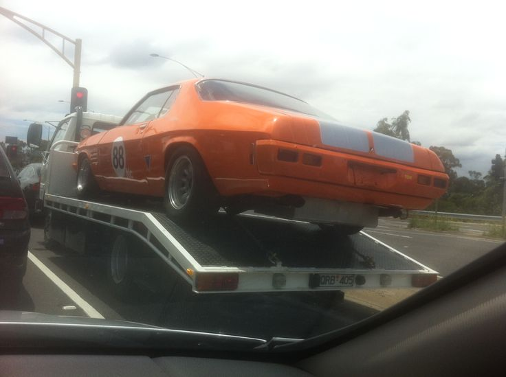 This HQ Holden Monaro needs to be about one metre closer to the road and road registered. Otherwise, it's cool as hell.