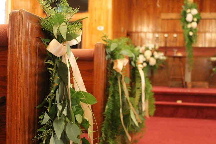 Southern Church Wedding:  Fresh native greenery was bundled and tied with blush satin ribbon to make the pew markers.