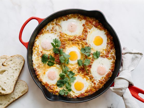 Delicious typical Israeli breakfast, that really can be eaten as lunch or even dinner! Sauce can be made in a advance to be reheated at the time that eggs are done. In this recipe, Ive reduced the amount of oil used to make it low fat, but you can use more if you need to.