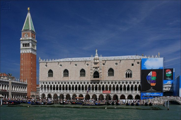 The Doge's Palace and St Mark's Clocktower totally disfigured by advertisement - Venice government sold everything for money also a beauty like Doge's Palace - Venezia - Veneto - Italy