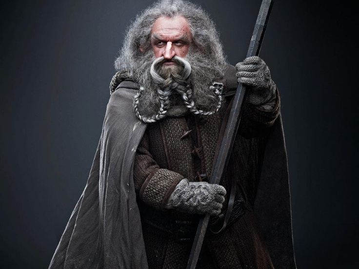 Óin is played by John Callen. Along with his brother Glóin, Óin is a distant cousin of Thorin Oakenshield. A brave Northern Dwarf, Óin joins The Company of Thorin Oakenshield out of a sense of loyalty to his kin, and also because he has a substantial sum of money invested in the venture. Well read with an inquiring mind, Óin is the healer among the Company, often applying an herbal salve of his own invention – which has since come to be known as 'ointment' after its maker.