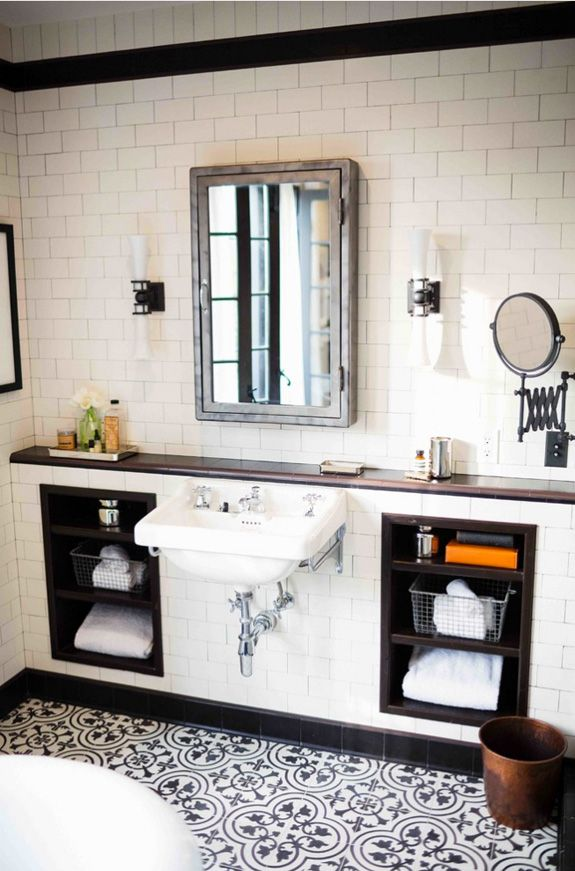 Black and white / neutral bathroom with patterned floor tiles and white subway