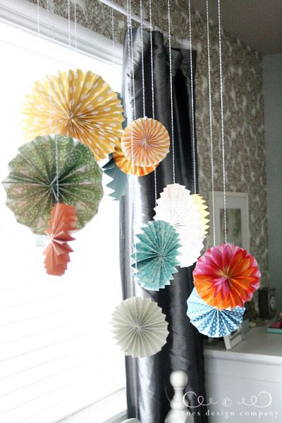 Easy paper medallions. Use scrapbook or quality wrapping paper. I've done wreaths (small sized medallions), wall hangings & ceiling hangers. Add a fun round paper center with a glued on button, flower, etc...I just love these!!