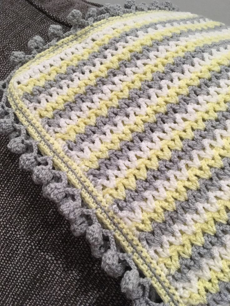 My fave blanket using v stitch in white, lemon, and silver Stylecraft dk and Pom Pom edging.