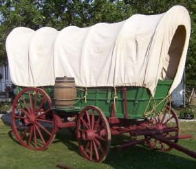 This is a Prarie Schooner and we used these on the Oregon trail and to get over the river we took the wheels off of these.