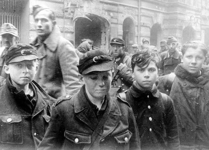 "Germany. The Last of the last in defense of Hitler and the Third Reich. Child ""soldiers"" caught during the Battle of Berlin, April-May 1945. Most of them were ordered to ditch the uniform and go home."