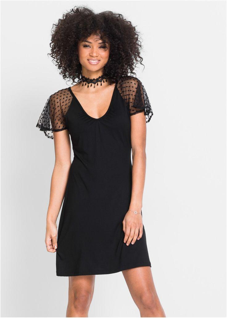 Bekijk nu:Modieuze jurk met netweefsel op de mouwen en diepe V-hals.