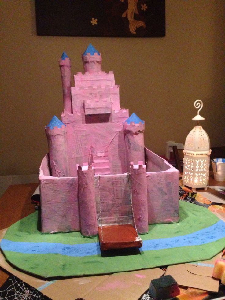 Castle with only one coat of paint on, you see still clearly see the newspaper underneath even though we painted it white before the pink.