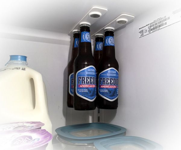 Beer me! BottleLoft attaches to the interior ceiling of your refrigerator via super strong 3m VHB adhesive. Simply peel and stick the BottleLoft to free up some space for whatever floats your boat. Or, in this case, your bottle. Image: Strong Like Bull Magnets
