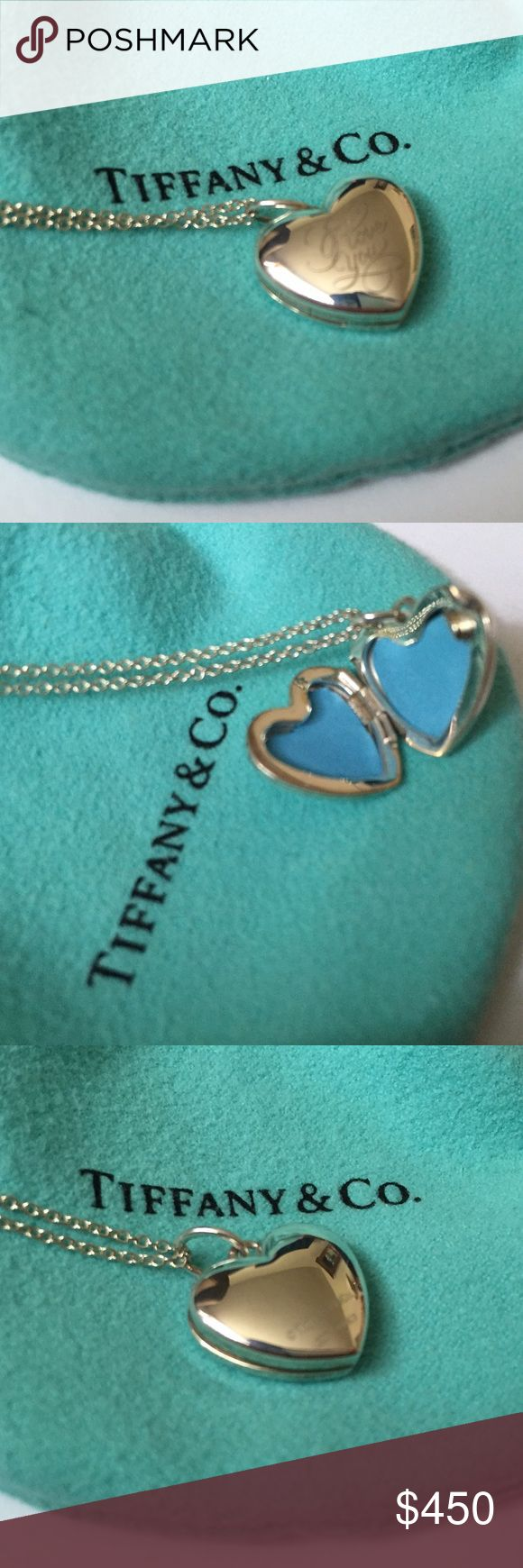 "NEVER WORN - Tiffany - Heart Shaped Locket & Chain Tiffany - ""I Love You"" Heart Shaped Locket. NEVER WORN. In GREAT condition. The 18 inch Tiffany's chain is also included, as well as the pouch, box, and white bow! Tiffany & Co. Jewelry Necklaces"