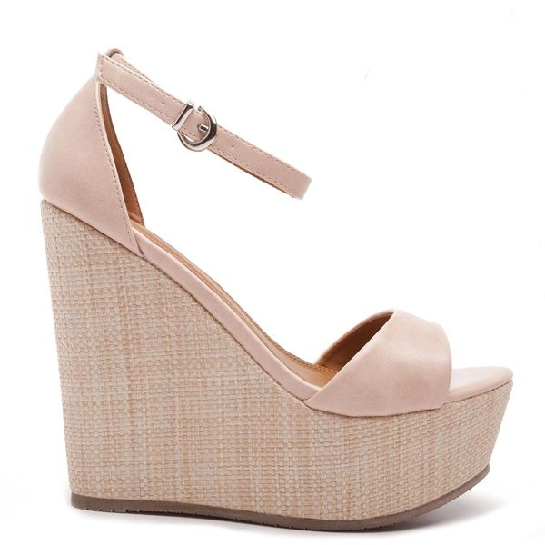 Pink high heel platforms with band and adjustable ankle strap.