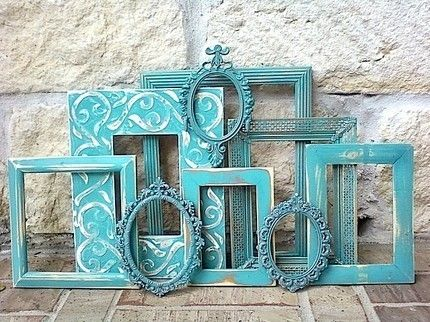 buy thrift store frames and spray paint the same color...