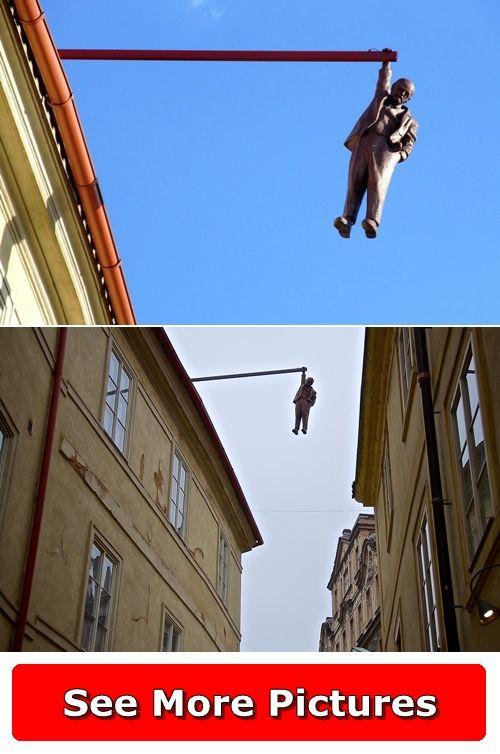 Find more pictures http://666travel.com/man-hanging-out-sculpture-prague-czech-republic/