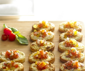 Ingredients  1 pkg. (6.5 oz.) Alouette Garlic & Herbs, or Alouette Savory Vegetable, or Alouette Peppercorn Parmesan Spreadable Cheese     12 slices of French bread (¼ inch thick)  1 ¼ cups fresh tomatoes, chopped and seeded  ¼ cup freshly grated parmesan cheese   ¼ cup fresh, chopped parsley or basil