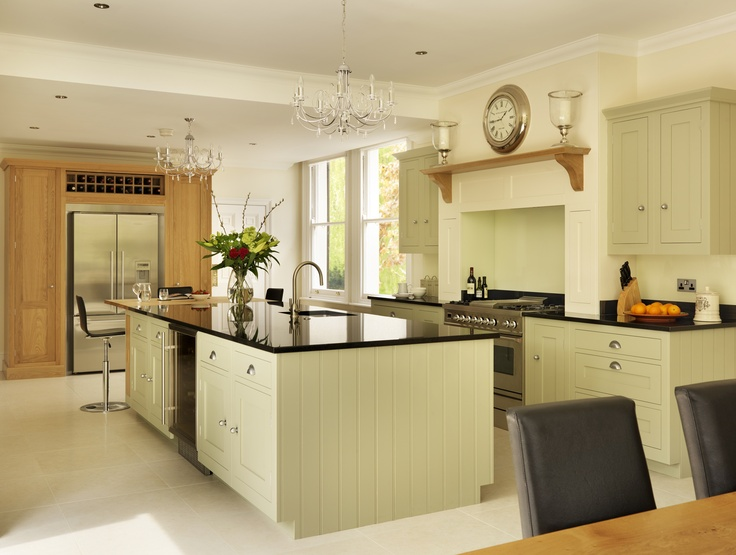 A Stainless Steel Sigma Range Cooker Sits Perfectly In This Timeless Pale  Green Shaker Kitchen.