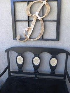 old windows..an old window..painted black hanging on the wall with a large initial ..in a worn white...attached to it...this would be nice at a wedding with the couples initial!