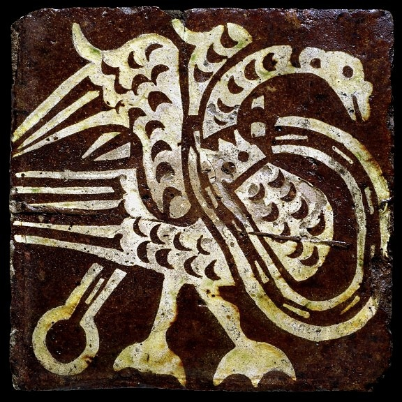 The inlaid tile was one of the great inventions of medieval craftsmen. Production of such tiles involved stamping the surface of an unfired slab of clay with a carved wooden block, impressing the design into the surface. The hollows were then filled with white clay. Inlaid tiles, primarily used for floors, were made in quantity in England from the 13th to the 16t