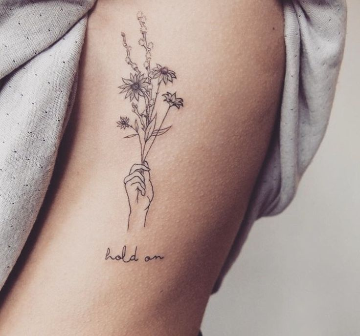 "outside the right wrist: ""sisters are different flowers from the same garden"" with my sister (flowers more in the hand …"